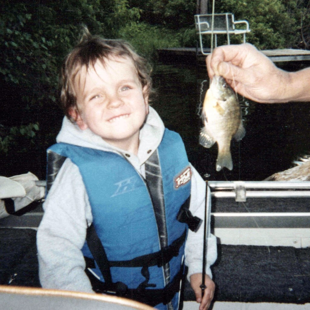 Patrick Immelman (2) catches his first fish in Harris Channel (which connects Little Rock Lake to the Mississippi River) on Father's Day, June 15, 2008.