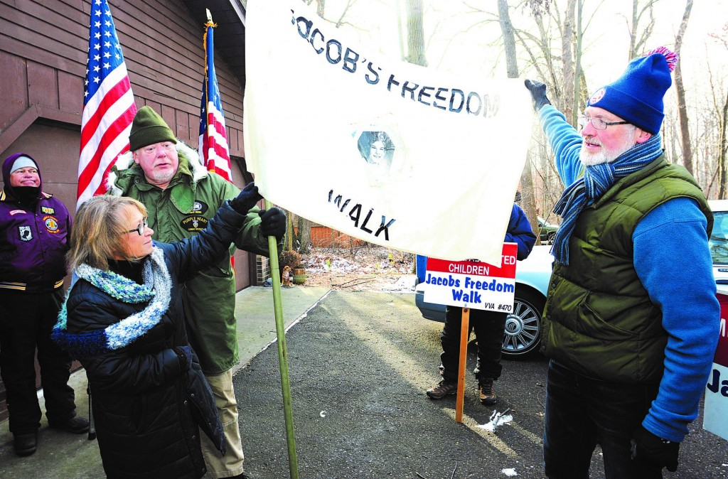 Mike Clark and fellow Anoka County Vietnam Veterans Chapter 470 members have carried this flag for Jacob since the first 60-mile walk  in December 1989. On Dec. 10, 2016, they walked from the abduction site and presented Patty and Jerry with the flag.