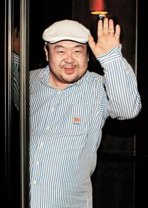 Kim Jong Nam, the eldest son of late North Korean leader Kim Jong Il, waves after an interview in Macau in June 2010. (Photo: Joongang Sunday / AFP -- Getty Images)
