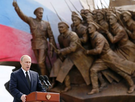 Russian President Vladimir Putin speaks Friday, Aug. 1, 2014 at the opening ceremony of the monument to the Heroes of World War I, behind him, on the day of the 100th anniversary of its beginning in Victory Park on Poklonnaya Hill in Moscow, Russia.